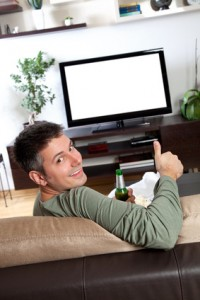 Real estate agent procrastinating by watching TV